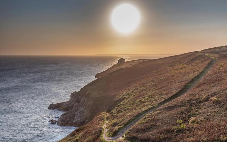 Sunset over the cliffs at Rinsey Head - Getty