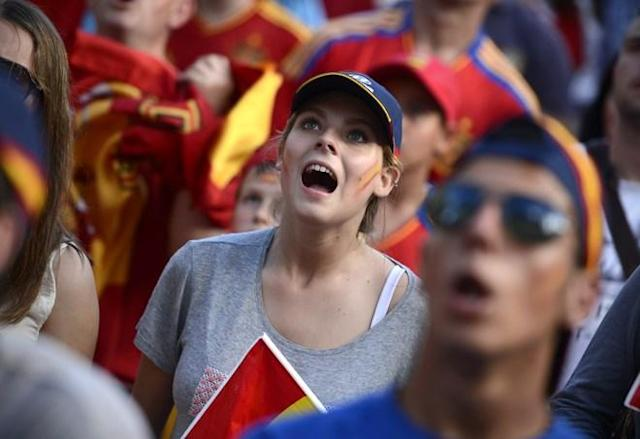 Supporters of the Spanish national football team react as they watch their team during the Euro 2012 Championships football match between Spain and Italy on June 10, 2012 near Santiago Bernabeu Stadium in Madrid. Holders Spain were held to a 1-1 draw by a dogged and determined Italy at the Arena Gdansk in the opening Group C match at the European Championship. AFP PHOTO/ DANI POZODANI POZO/AFP/GettyImages