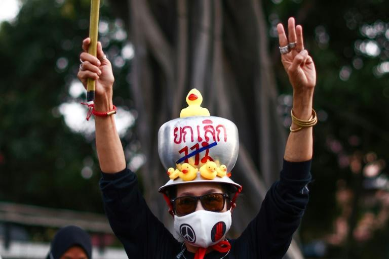 One protestor wore a pan on her head, with the words 'Abolish 112' painted on it -- a reference to Thailand's lese majeste law