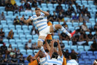 Argentina's Guido Petti, top, loses his balance as he is lifted in a line out during their Rugby Championship test match against Australia on the Gold Coast, Australia, Saturday, Oct. 2, 2021. (AP Photo/Tertius Pickard)