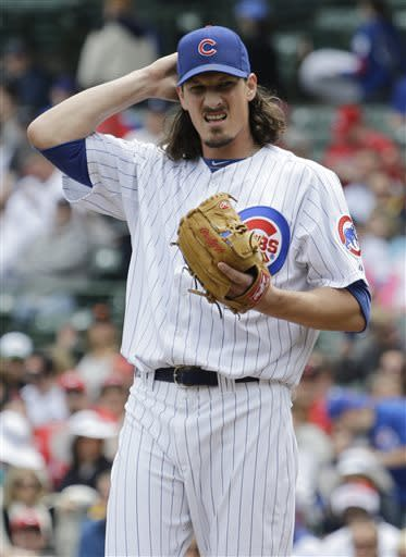 Chicago Cubs starter Jeff Samardzija reacts as he adjusts his hat during the first inning of a baseball game against the Cincinnati Reds in Chicago, Saturday, May 4, 2013. (AP Photo/Nam Y. Huh)