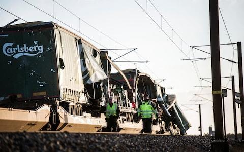 Images from the accident site showed a damaged freight train that appeared to be carrying beer - Credit: RITZAU SCANPIX/REUTERS