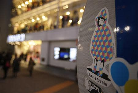 A sticker art made by an artist known as 281 Antinuke, is seen on the back of a traffic signboard on a street in Tokyo November 26, 2013. REUTERS/Yuya Shino