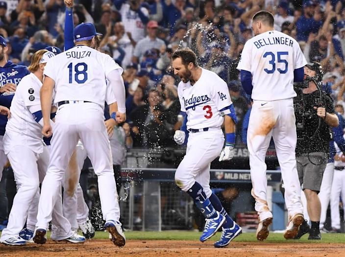 Los Angeles Dodgers left fielder Chris Taylor celebrates while crossing home after hitting the game-winning home run