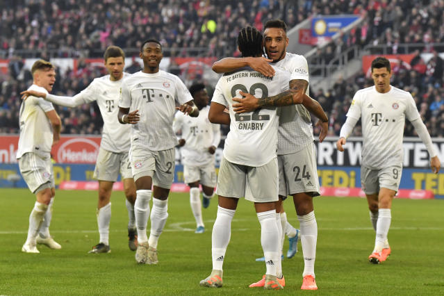 Bayern's Corentin Tolisso (24) celebrates after scoring his side's second goal during the German Bundesliga soccer match between Fortuna Duesseldorf and FC Bayern Munich in Duesseldorf, Germany, Saturday, Nov. 23, 2019. (AP Photo/Martin Meissner)