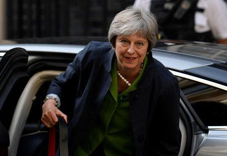 Britain's Prime Minister May returns to Downing Street from the Houses of Parliament in London, Britain