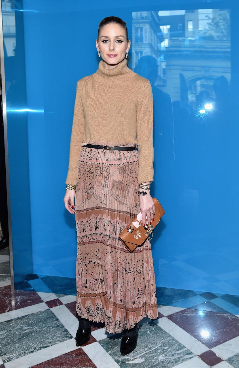<p>Olivia Palermo cosied up in a camel knit. <i>[Photo: Getty]</i> </p>