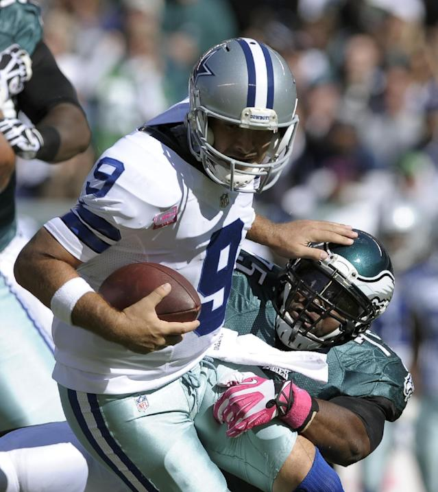 Dallas Cowboys quarterback Tony Romo (9) is sacked by Philadelphia Eagles defensive end Vinny Curry (75) during the first half of an NFL football game, Sunday, Oct. 20, 2013, in Philadelphia. (AP Photo/Michael Perez)