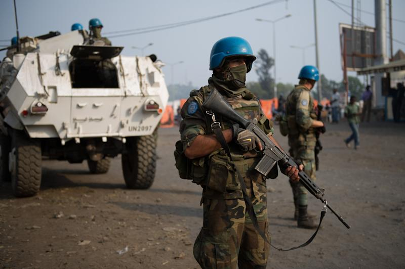 United Nations peacekeepers stand in front of their armoured personnel carrier, on patrol in the city of Goma in the east of the Democratic Republic of the Congo on July 13, 2012 (AFP Photo/Phil Moore)