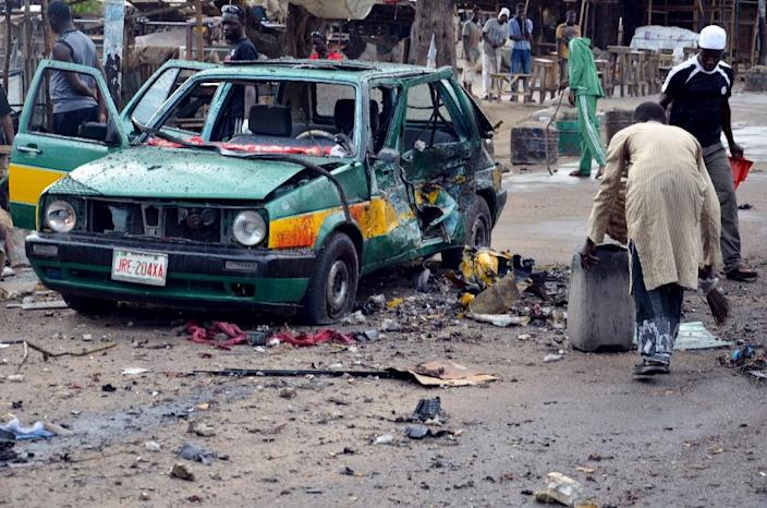 A taxi burned out in the blast pictured in Maiduguri on July 31, 2015 after a female suicide bomber targeted a market in the northeastern Nigerian city (AFP Photo/)