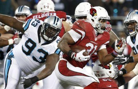 FILE PHOTO: Jan 24, 2016; Charlotte, NC, USA; Arizona Cardinals running back David Johnson (31) runs the ball as Carolina Panthers defensive tackle Kyle Love (93) defends during the second quarter in the NFC Championship football game at Bank of America Stadium. Jason Getz-USA TODAY Sports / Reuters Picture Supplied by Action Images