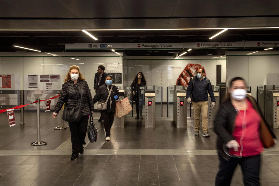 ROME, ITALY - APRIL 27: People leave the San Giovanni metro station during an ATAC (Public transport agency of Rome) test scenario, to experiment with social distance and the maximum entry of 30 people on trains, during the Coronavirus (COVID-19) pandemic, on April 27, 2020 in Rome, Italy. Italy will remain on lockdown until May 4th to stem the transmission of the Coronavirus (Covid-19), but some industries are being allowed to reopen. (Photo by Antonio Masiello/Getty Images)