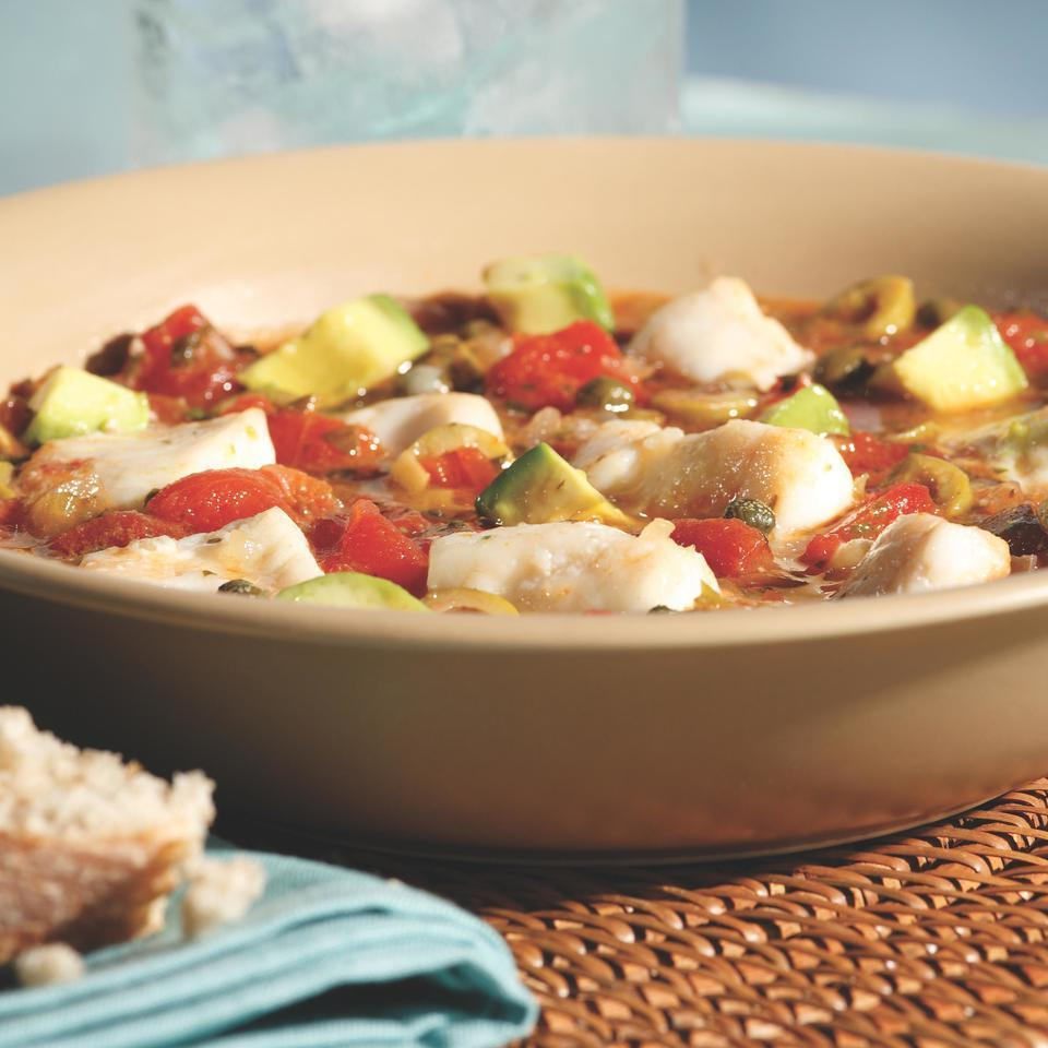 <p>Bacalao, salted dried codfish, is the defining ingredient in traditional Puerto Rican fish stew, but salt cod requires overnight soaking and several rinses in cool water before it can be used, so we opt for fresh fish in this quick version. Serve with crusty rolls to soak up the juices.</p>
