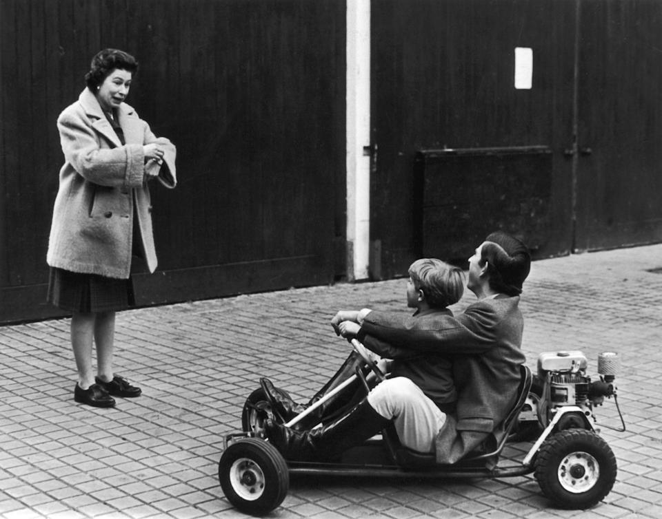 Charles riding a go-kart with Edward in 1969 while Queen Elizabeth looks on.