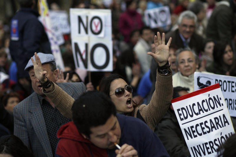 A woman shouts slogans against Spanish government during a demonstration against health and education cuts recently announced by the Spanish government, in Madrid, Spain, Sunday, April 15, 2012. (AP Photo/Alberto Di Lolli)