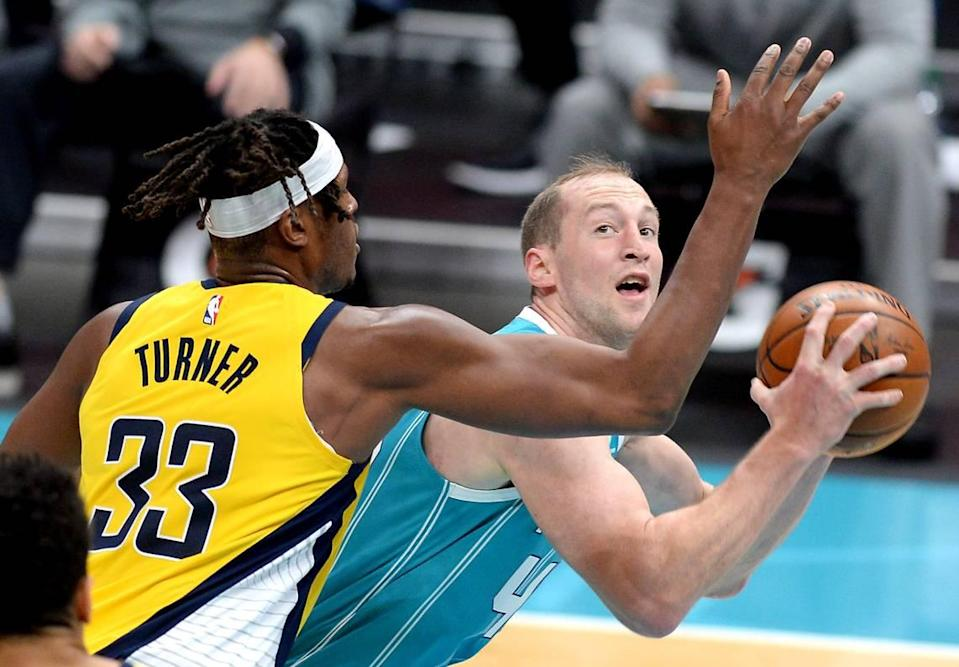 Charlotte Hornets center Cody Zeller, right, looks to fake Indiana Pacers forward/center Myles Turner on a shot attempt during second half action Friday.