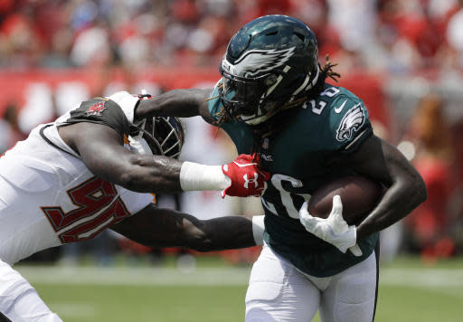 Philadelphia Eagles running back Jay Ajayi (26) gets away from a tackle by Tampa Bay Buccaneers defensive end Jason Pierre-Paul (90), during the first half of an NFL football game, Sunday, Sept. 16, 2018, in Tampa, Fla. (AP Photo/Chris O'Meara)