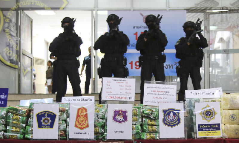 Thai policemen stand in front of packages of methamphetamines on display during a press conference at Narcotics Suppression Bureau Bangkok, Thailand, Monday, July 15, 2019. Police said they seized 459 kilograms (1,012 pounds) of crystal methamphetamine last week that they suspect originated from neighboring Myanmar. The drugs were found in the back of a pickup truck covered under a large green canvas. (AP Photo)