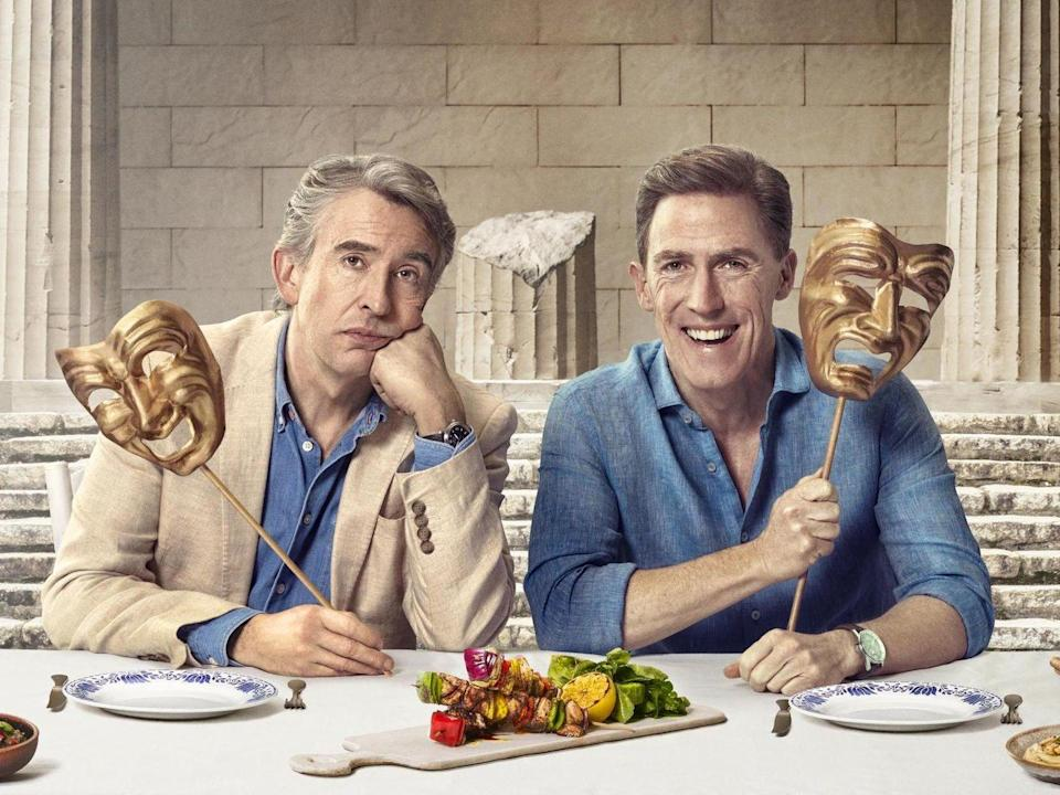 """<p>Steve Coogan and Rob Brydon follow the path first traversed by Odysseus in <em>The Trip To Greece</em>, once again engaging in the witty banter and dueling celebrity impressions that have become the hallmark of this Michael Winterbottom-stewarded comedy series. For this fourth and ostensibly final installment, the bickering couple (Coogan arrogant and condescending; Brydon cheery and patient) enjoy fine meals and show off their imitative vocal skills, here highlighted by Coogan doing a pitch-perfect Ray Winstone as King Henry VIII. In keeping with its predecessors, the duo's latest colors its humor with a strain of wistful regret rooted in their thorny feelings about transitioning into middle age. Anxiety about mortality turns out to be more pronounced than ever, particularly via Coogan's Ingmar Bergman-esque dream sequence, which is related to dismay over his father's failing health. Nonetheless, the alternately combative and chummy English pair remain in fine, funny form, and their swan song proves to be their most substantive collaboration since their maiden outing.</p><p><a class=""""link rapid-noclick-resp"""" href=""""https://www.amazon.com/Trip-Greece-Steve-Coogan/dp/B088QLCBQ4?tag=syn-yahoo-20&ascsubtag=%5Bartid%7C10054.g.29500577%5Bsrc%7Cyahoo-us"""" rel=""""nofollow noopener"""" target=""""_blank"""" data-ylk=""""slk:Watch Now"""">Watch Now</a></p>"""