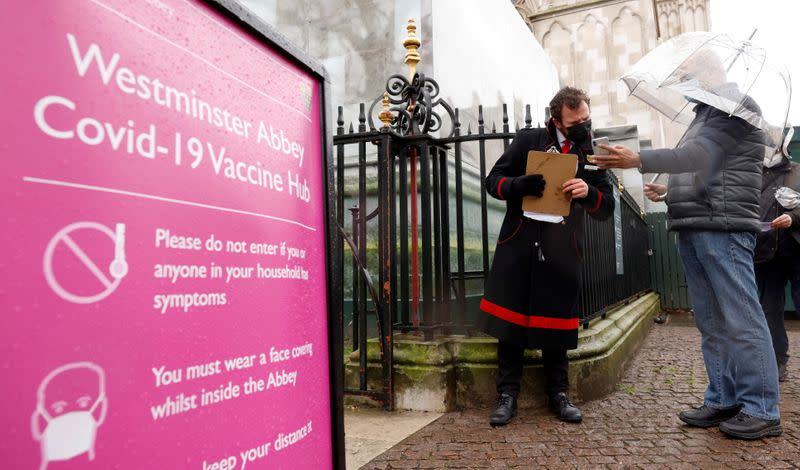 Patients are greeted by Abbey staff outside a vaccination centre at Westminster Abbey, amid the outbreak of coronavirus disease (COVID-19), in London