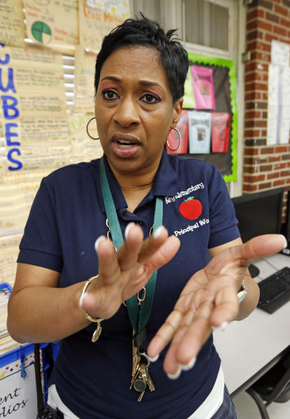Key Elementary School principal Dionne Woody says her third grade teachers were plowing ahead with reading instruction at the Jackson, Miss., school, Thursday, April 18, 2019, even after their students took the state mandated reading tests, to ensure students are ready for fourth grade. The continued emphasis on reading also gives kids who fail initially a fighting chance on a retest. (AP Photo/Rogelio V. Solis)
