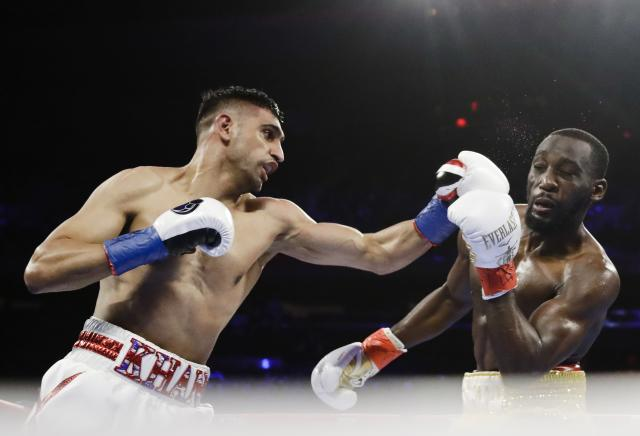 England's Amir Khan, left, punches Terence Crawford during the second round of a WBO world welterweight championship boxing match Sunday, April 21, 2019, in New York. Crawford won the fight. (AP Photo/Frank Franklin II)