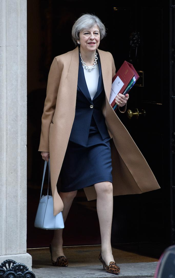 For Prime Minister's Questions, Theresa May kept warm in a camel coat [Photo: Getty]