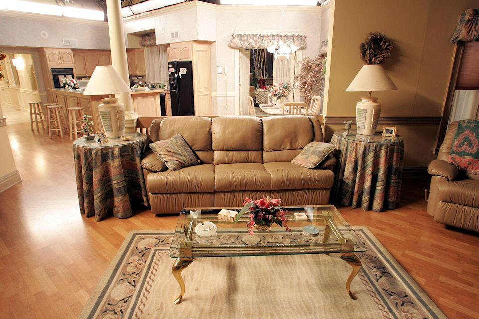 <p>Nestled between two side tables, the carefully-chosen sofa in the crime family's living room was surprisingly cozy. </p>