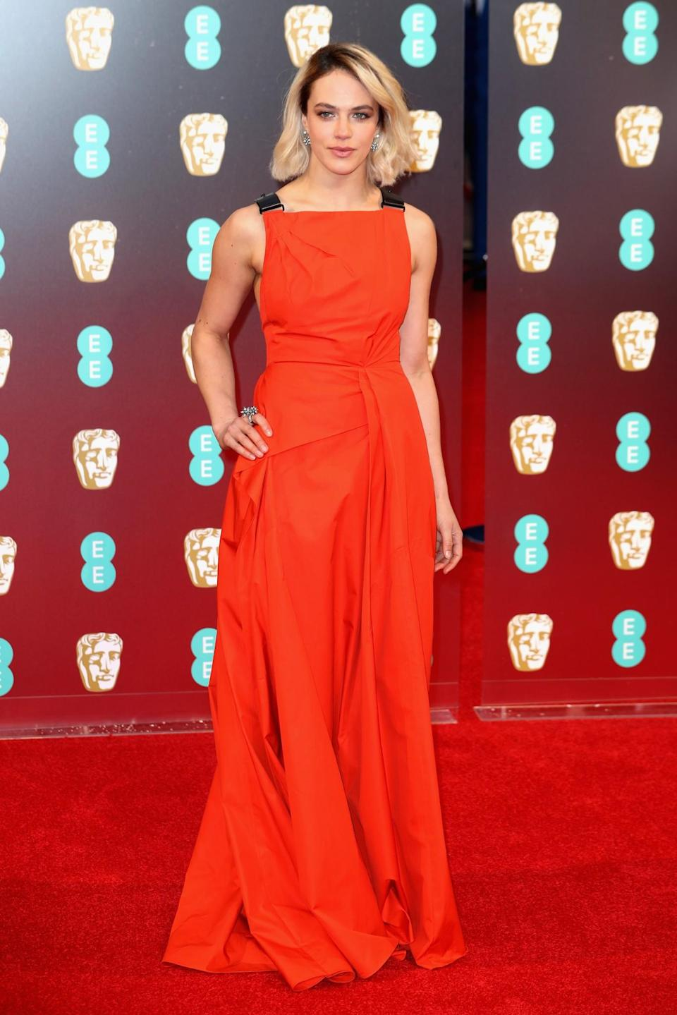 <p>The <i>Downton Abbey</i> star showcased a new blonde bob with a stand-out orange dress. <i>[Photo: Getty]</i> </p>