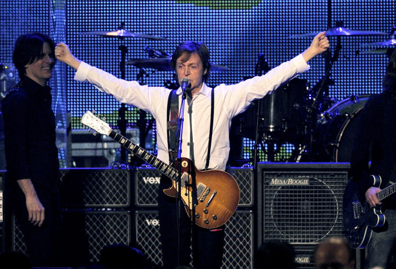 "FILE - This Feb. 10, 2012 file photo shows Paul McCartney performing at the MusiCares Person of the Year gala in his honor in Los Angeles. McCartney will play on a 1877 Steinway grand piano he discovered and had refurbished at Detroit's Motown Museum. Word came down late Wednesday, Aug. 29, that the new and improved 9-foot Victorian rosewood will have its coming-out party at a Sept. 18 charity event in New York City before returning to its home on West Grand Boulevard in Detroit. McCartney and Motown founder Berry Gordy will play the piano at the New York event, dubbed ""Project: Harmony."" (AP Photo/Chris Pizzello, file)"