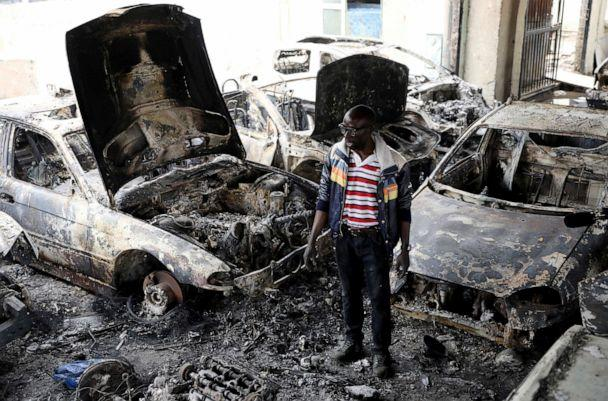 PHOTO: Nigerian entrepreneur Basil Onibo, one of the victims of the latest spate of xenophobic attacks looks at the burnt out cars at his dealership in Johannesburg, South Africa, Sept. 5, 2019. (Siphiwe Sibeko/Reuters)