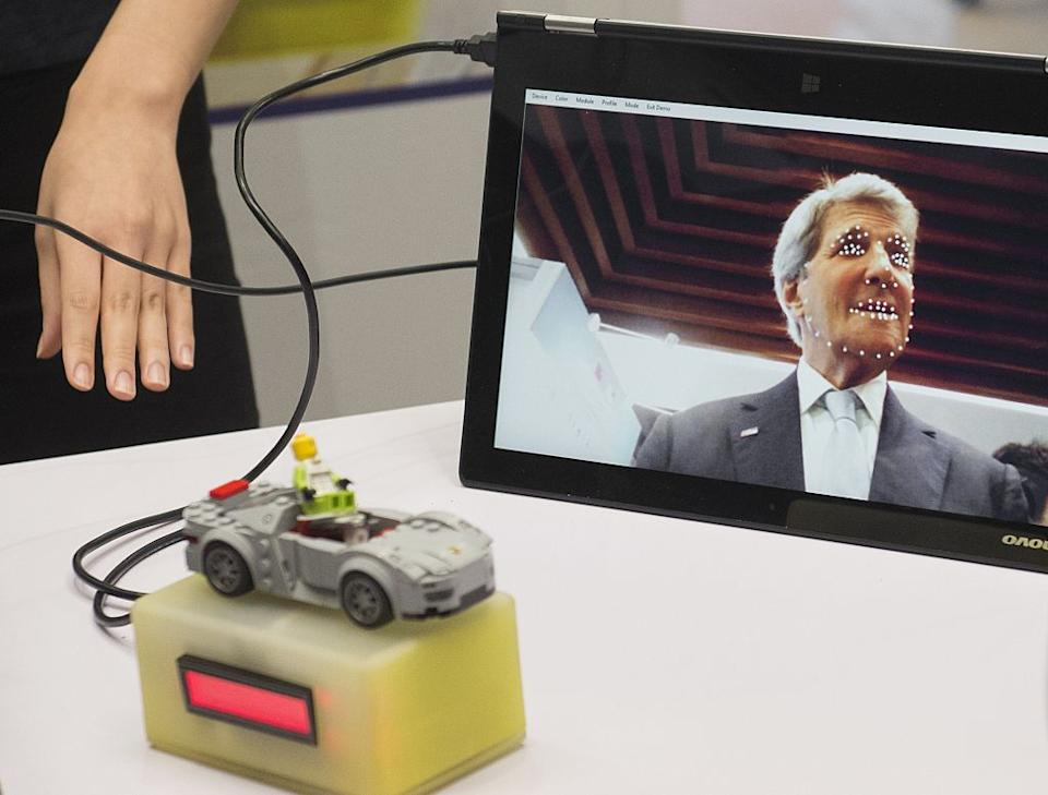 Former US Secretary of State John Kerry appears on a tablet for a device that helps notify a person's level of fatigue while driving. Source: Getty
