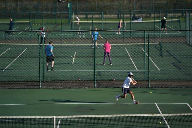 A general view of people playing tennis at Nottingham Tennis Centre
