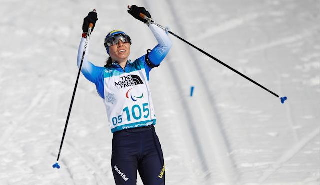 Biathlon - Pyeongchang 2018 Winter Paralympics - Women's 10km - Visually Impaired - Alpensia Biathlon Centre - Pyeongchang, South Korea - March 13, 2018 - Oksana Shyshkova of Ukraine celebrates winning the gold as she crosses the finish line. REUTERS/Carl Recine