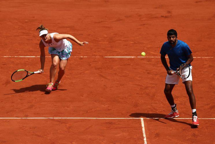 Gabriela Dabrowski of Canada and Rohan Bopanna work to finish strong in their final match of the 2017 French Open against Anna-Lena Groenefeld of Germany and Robert Farah of Columbia. (Getty Images)