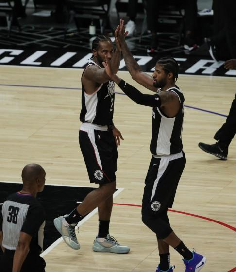Clippers forwards Kawhi Leonard and Paul George celebrate during a playoff win over Utah.