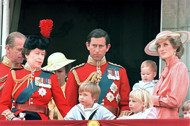 The royal family (now including Prince Harry) watch a military procession from Buckingham Palace in honor of the Queen's birthday.