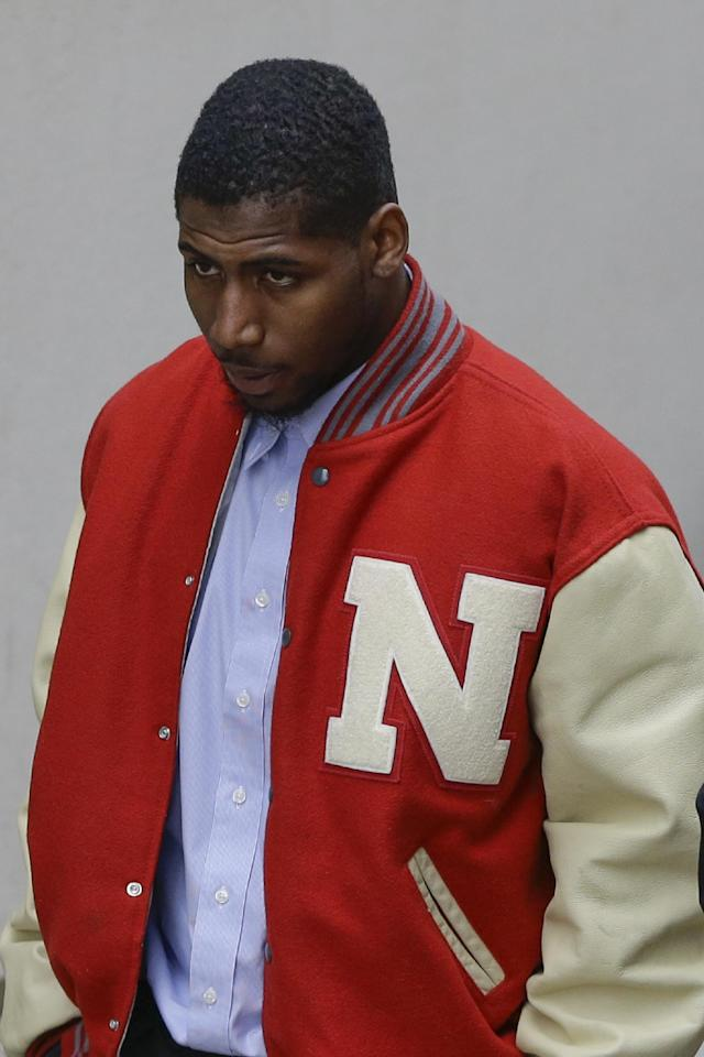 FILE - In this April 11, 2013 file photo, New England Patriots cornerback Alfonzo Dennard walks outside the Lancaster County courthouse in Lincoln, Neb. Dennard has reported to a Lincoln jail to begin his 60-day term for a 2012 assault on a police officer. Corrections officers with the Lancaster County Adult Detention Facility who spoke on condition of anonymity because of jail policy said Dennard reported to the Lincoln facility Saturday morning, March 1, 2014. (AP Photo/Nati Harnik, File)