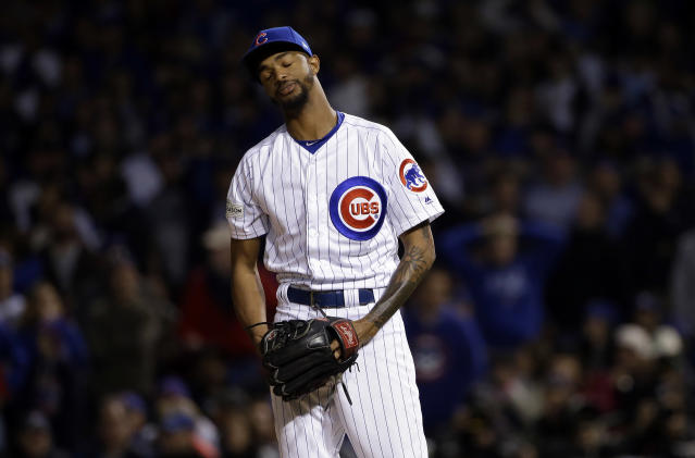 Chicago Cubs relief pitcher Carl Edwards Jr. reacts after walking Los Angeles Dodgers' Yu Darvish during the sixth inning of Game 3 of baseball's National League Championship Series, Tuesday, Oct. 17, 2017, in Chicago. (AP Photo/Nam Y. Huh)