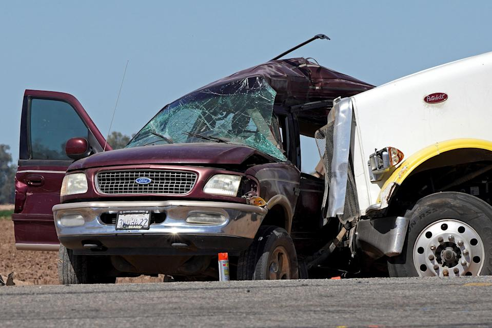 A maroon Ford Expedition which had been crammed with more than two dozen people is seen after it was involved in a deadly collision with a semitruck near Holtville, California, on Tuesday, March 2, 2021. / Credit: Bing Guan / Reuters