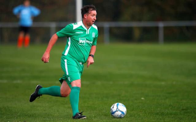 FILE PHOTO: Ex-Liverpool footballer Robbie Fowler, playing for the MPs' team, takes part in the annual MPs v journalists football match, at the start of the Labour Party conference in Liverpool