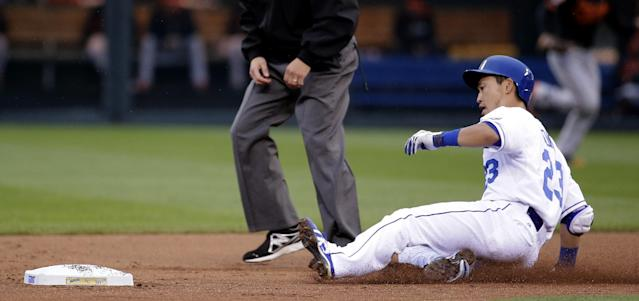 Kansas City Royals' Norichika Aoki slides into second after hitting a double during the first inning of a baseball game against the Baltimore Orioles on Friday, May 16, 2014, in Kansas City, Mo. (AP Photo/Charlie Riedel)