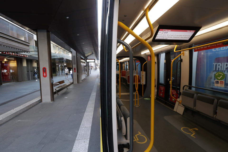A tram and its platform are empty in Sydney on Aug. 13, 2021, as greater Sydney continues a weeks-long COVID-19 lockdown. Japan, Australia and New Zealand all got through the first year of the coronavirus pandemic in relatively good shape, but now are taking very divergent paths in dealing with new outbreaks of the fast-spreading delta variant. (AP Photo/Rick Rycroft)