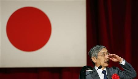 Bank of Japan Governor Kuroda gestures as he speaks during a seminar in Tokyo