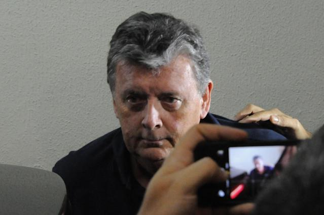 The CEO of Match Hospitality, a subsidary company of FIFA in charge of World Cup ticket packages, Raymond Whelan sits at a police station in Rio de Janeiro after being arrested on July 7, 2014 (AFP Photo/Tasso Marcelo)