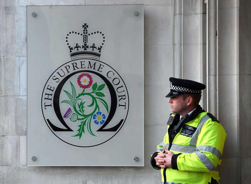 FILE PHOTO: A policeman stands outside the Supreme Court to hear the decision whether Theresa May's government requires parliamentary approval to start the process of leaving the EU