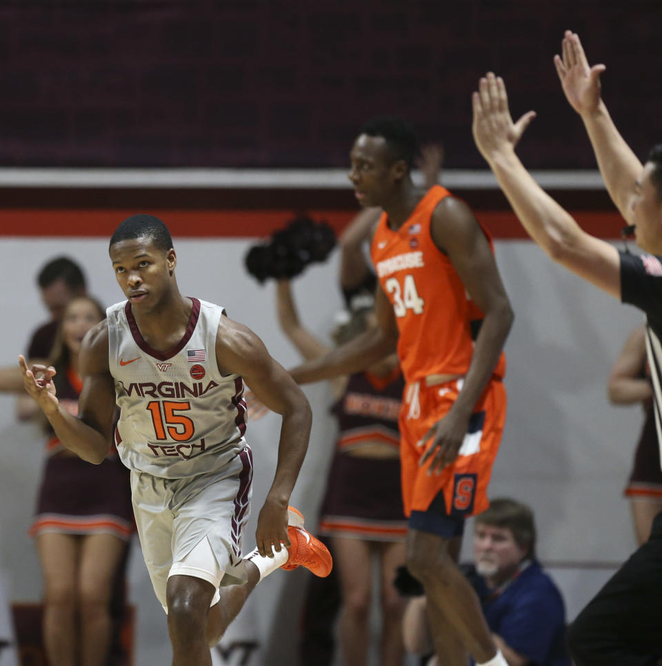 Virginia Tech's Jalen Cone (15) celebrates making a 3-point basket against Syracuse during the first half of an NCAA college basketball game in Blacksburg Va., Saturday, Jan. 18 2020. (Matt Gentry/The Roanoke Times via AP)