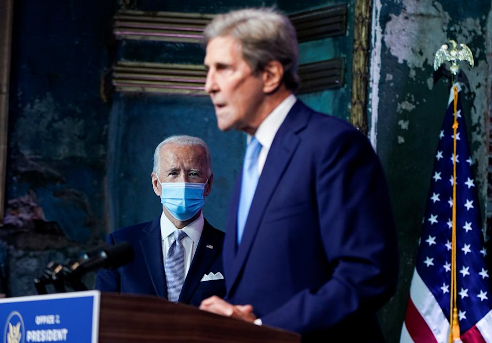 U.S. President-elect Joe Biden listens as former U.S. Secretary of State John Kerry, his special presidential envoy for climate appointee, speaks as President-elect Biden announces his national security nominees and appointees at his transition headquarters in Wilmington, Delaware, U.S., November 24, 2020. REUTERS/Joshua Roberts