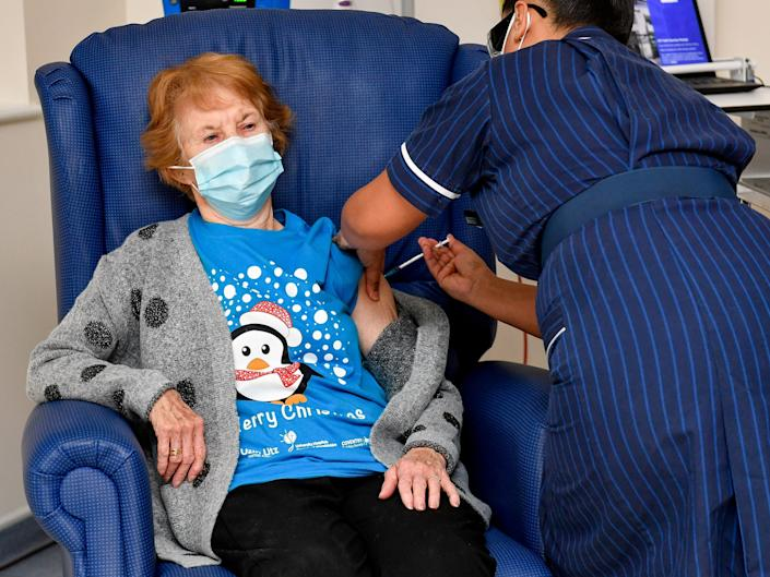 Margaret Keenan, 90, is the first patient in Britain to receive the Pfizer/BioNtech COVID-19 vaccine at University Hospital, administered by nurse May Parsons, at the start of the largest ever immunisation programme in the British history, in Coventry, Britain December 8,2020. Britain is the first country in the world to start vaccinating people with the Pfizer/BioNTech vaccine. Jacob King/Pool via REUTERS