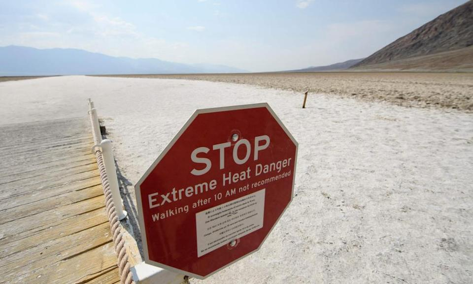 A sign warns of extreme heat danger at the salt flats in Death Valley national park.
